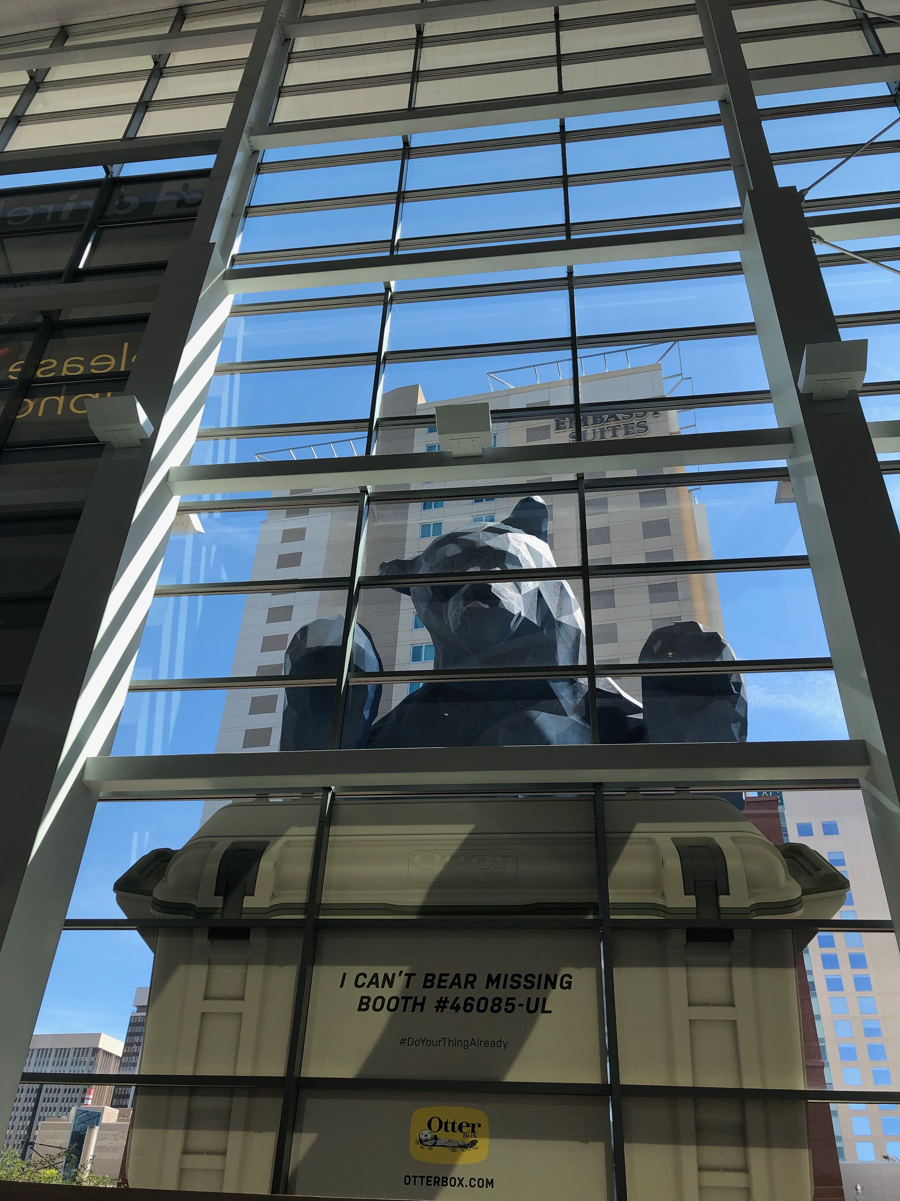 Big Blue Bear looking in to conference center